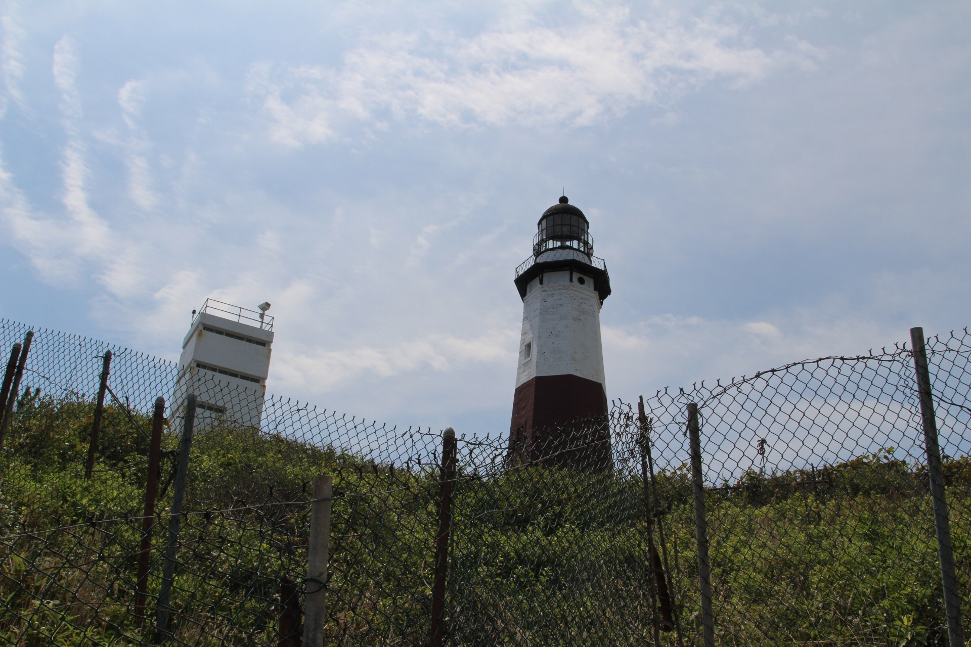 Momtauk Lighthouse on hill_with fence_2