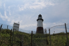 Momtauk Lighthouse on hill_with fence_1